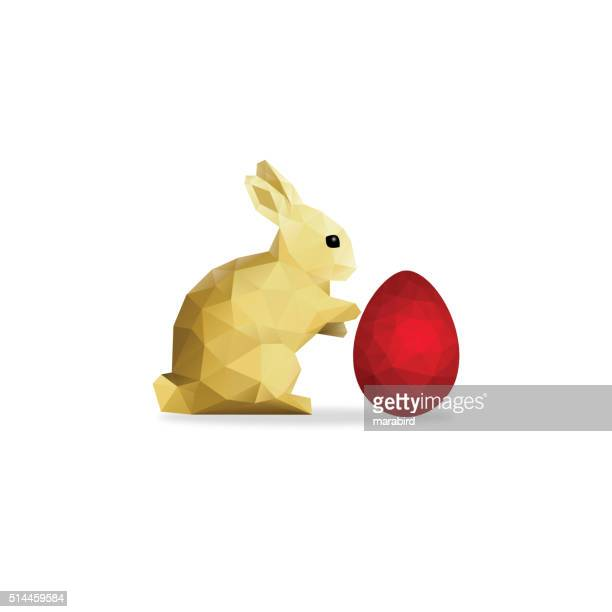 low poly gold rabbit and red easter egg over white - easter bunny stock illustrations, clip art, cartoons, & icons