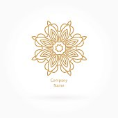 Luxury logotype for antique boutique. Gold logo, flower. Vintage bud.