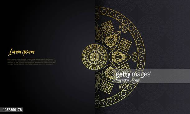 luxury ornamental mandala design background in gold color - mandalas india stock illustrations