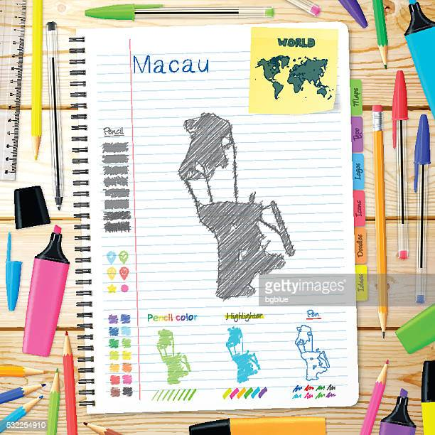 macau maps hand drawn on notebook. wooden background - macao stock illustrations