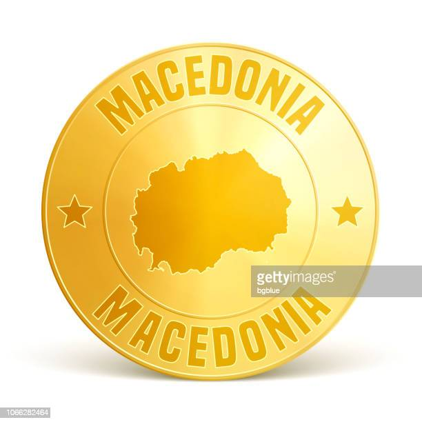Macedonia - Gold coin on white background