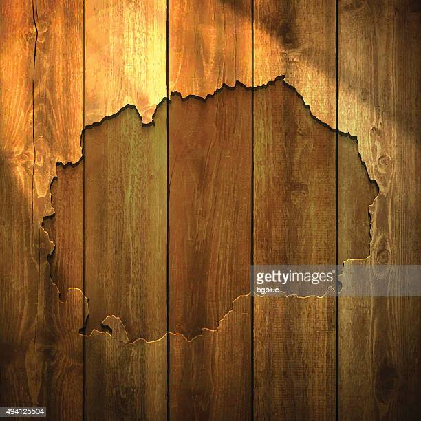 Macedonia Map on lit Wooden Background