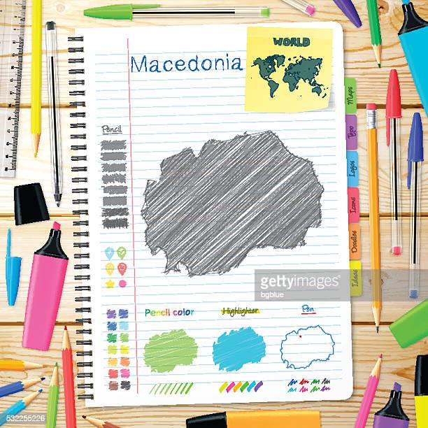 Macedonia maps hand drawn on notebook. Wooden Background