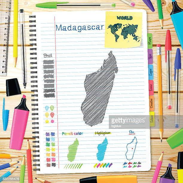 madagascar maps hand drawn on notebook. wooden background - antananarivo stock illustrations, clip art, cartoons, & icons