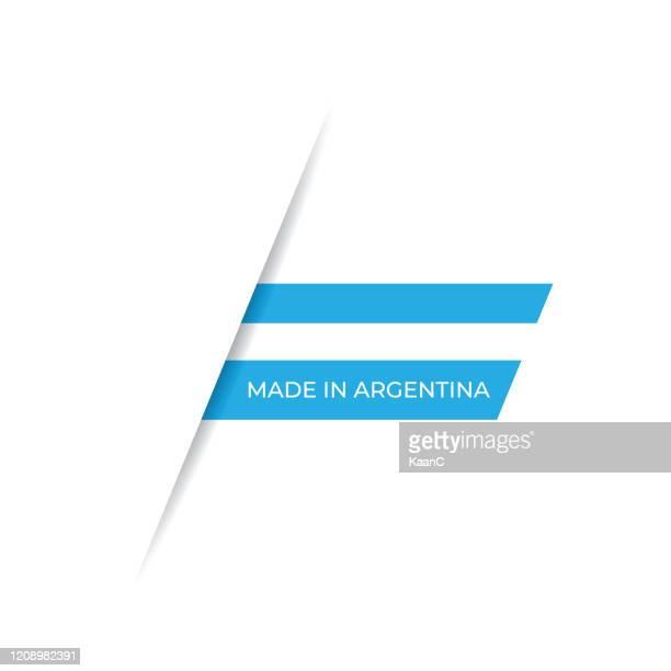 ilustraciones, imágenes clip art, dibujos animados e iconos de stock de hecho en la etiqueta argentina, ilustración de stock de emblema de producto - bandera argentina