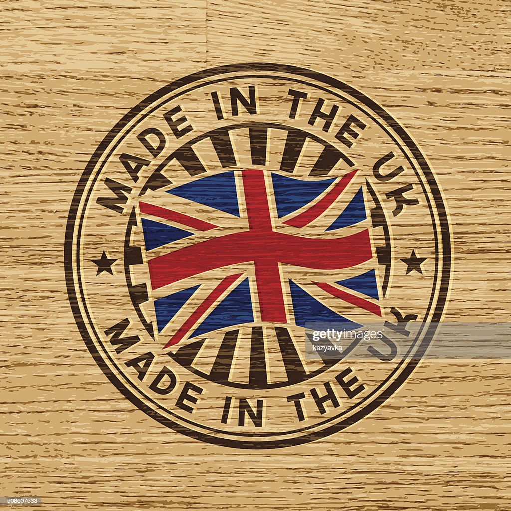 Made in the UK. Stamp on wooden background