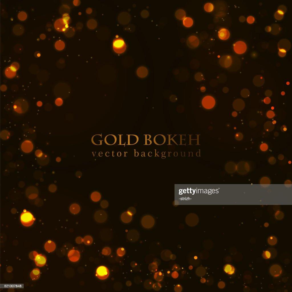 Magic sparkle, gold dots on dark background. Vector bokeh effect
