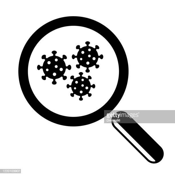 magnifying glass and virus cell close up. - infectious disease stock illustrations