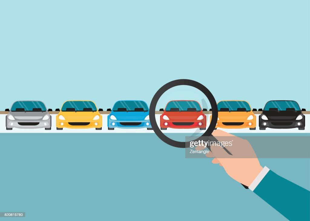 Magnifying glass in human hand with car.