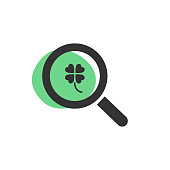 Magnifying glass looking for a four-leaf clover isolated web icon