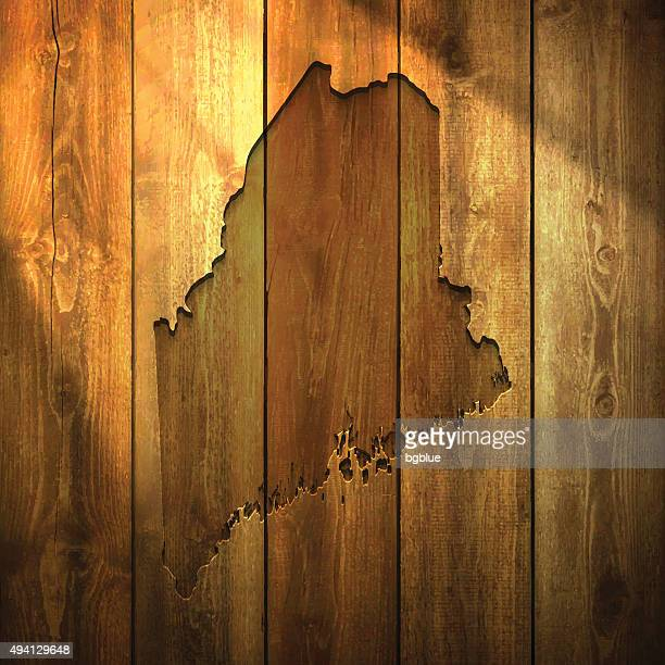 Maine Map on lit Wooden Background