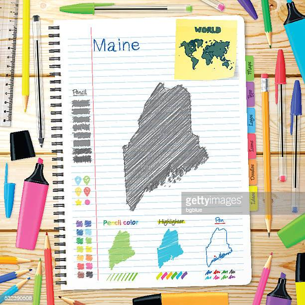 Maine maps hand drawn on notebook. Wooden Background