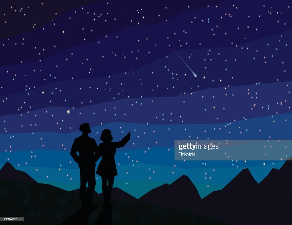 Make a wish. Silhouette of couple, watching falling star.