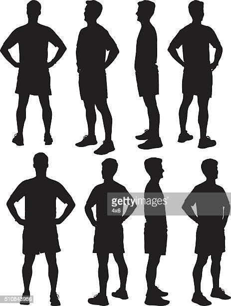 ilustrações, clipart, desenhos animados e ícones de atleta masculino em pé - mão no quadril