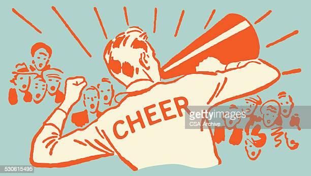 männliche cheerleader mit megafon führenden eine menge - megafon stock-grafiken, -clipart, -cartoons und -symbole