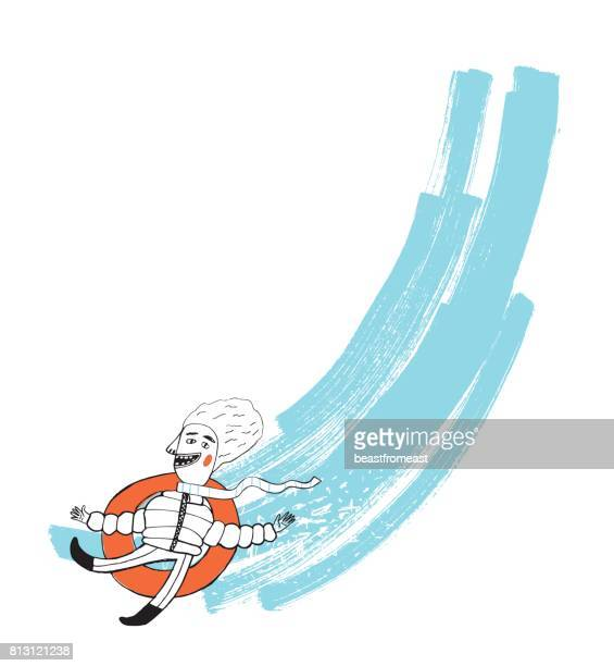 Male going down the hill on rubber tube