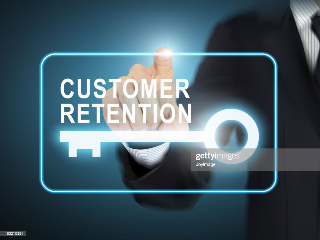 male hand pressing customer retention key button