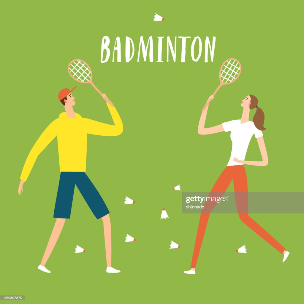 Man and woman at the park playing badminton
