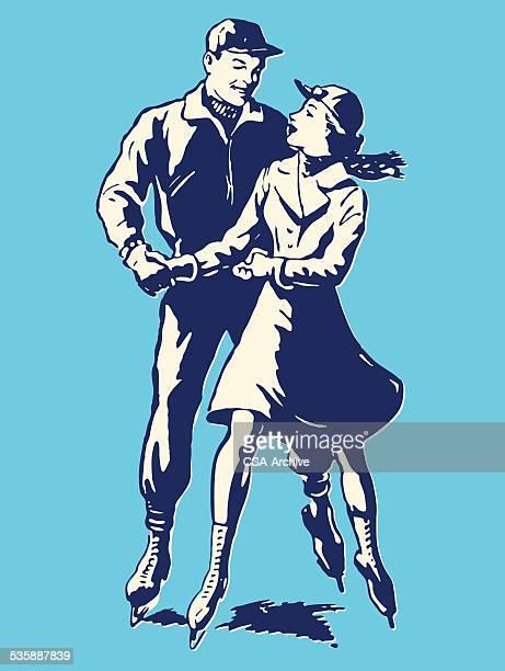 男性と女性のアイススケート