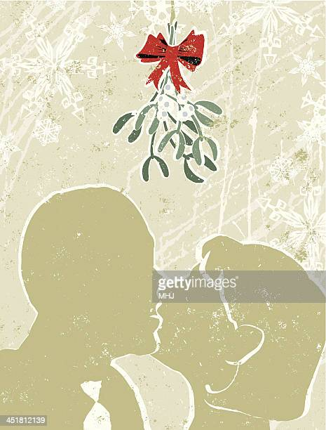 Man and Woman Kissing Under The Mistletoe