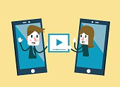 Man and woman sending and share video on smartphone.