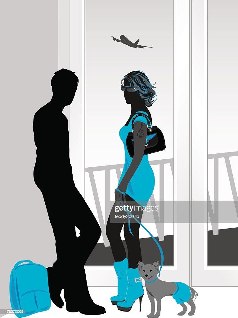 Man and woman talking at a airport terminal