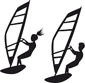 Man and woman windsurfing silhouettes