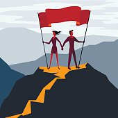 Man and woman with flag on a Mountain peak