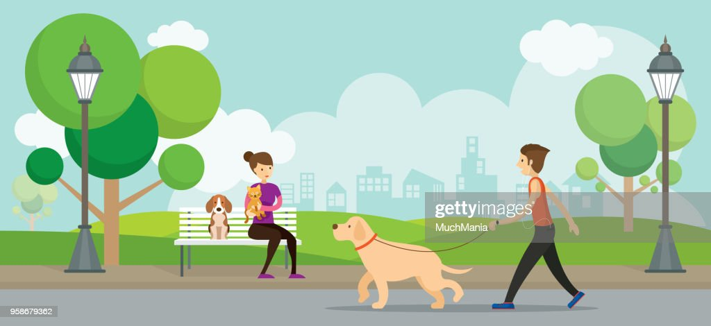 Man and Woman with Pets in the Park