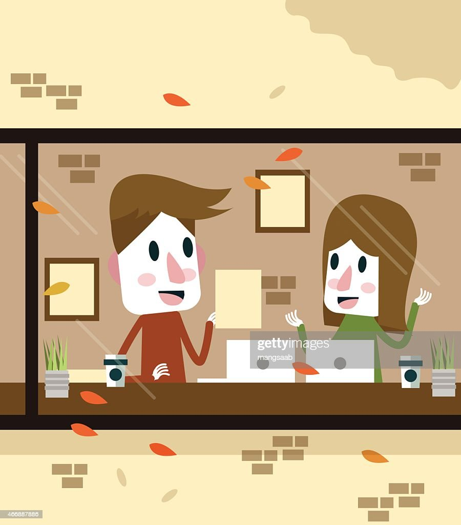 Man and Woman working in coffee shop.