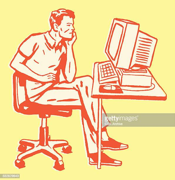 Man at Desk Staring at Computer