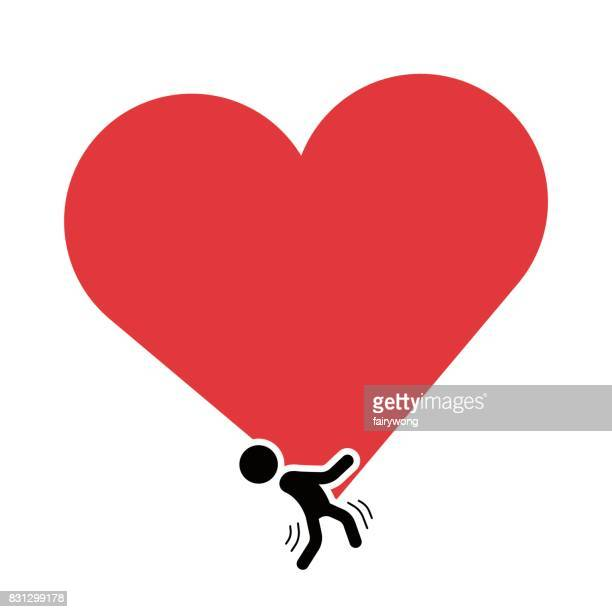 Man carrying a red heart shape