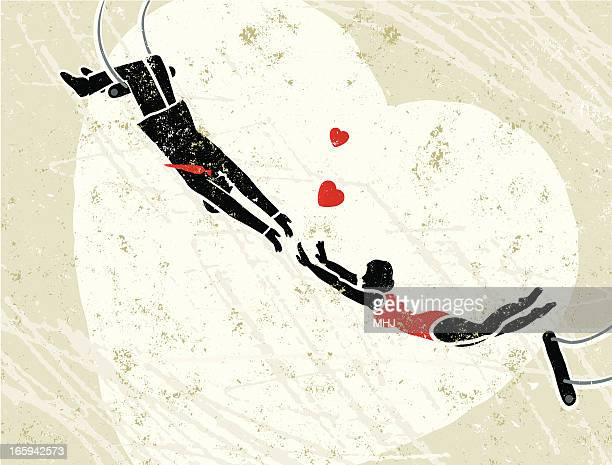 Man Catching a Woman Trapeze Artist with Hearts
