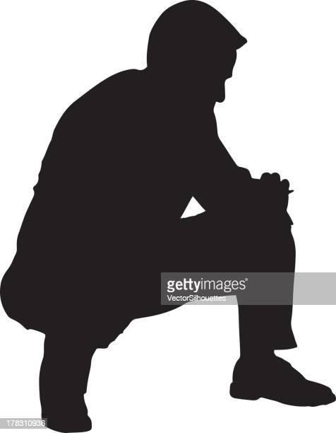 man crouching silhouette - crouching stock illustrations, clip art, cartoons, & icons