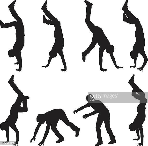 Man doing handstands and walking on hands
