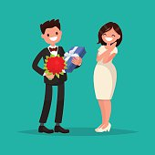 Man dressed in a suit gives a woman a bouquet