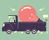 Man driving a truck and delivering a great idea light bulb