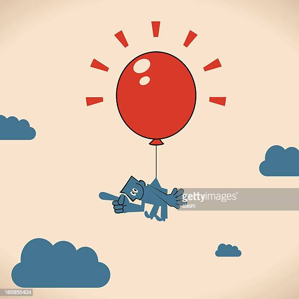 Man floating with a Big Red Balloon
