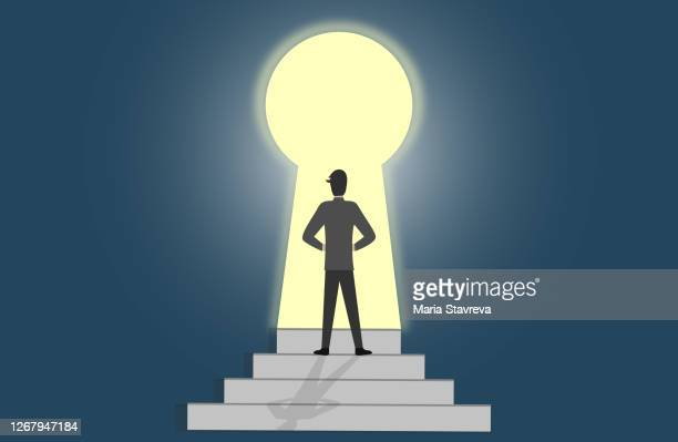 man getting out of darkness through keyhole shaped door. get the access to success. - mystery stock illustrations