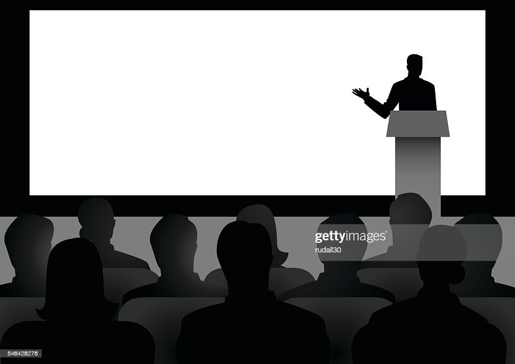 Man Giving A Speech On Stage