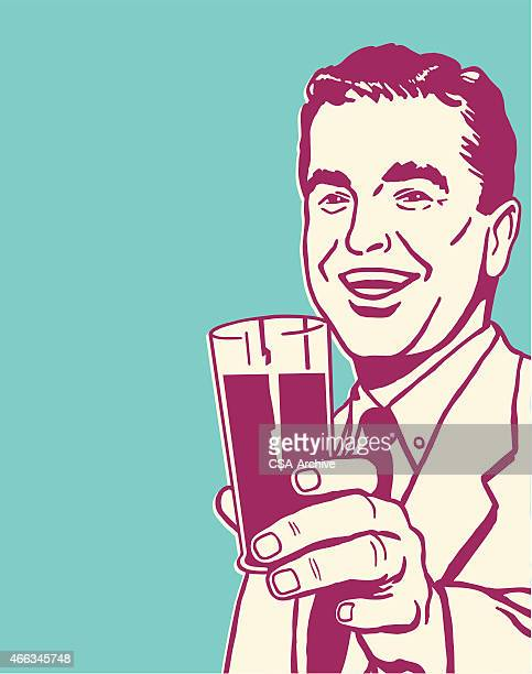 Man Holding Beverage in Glass