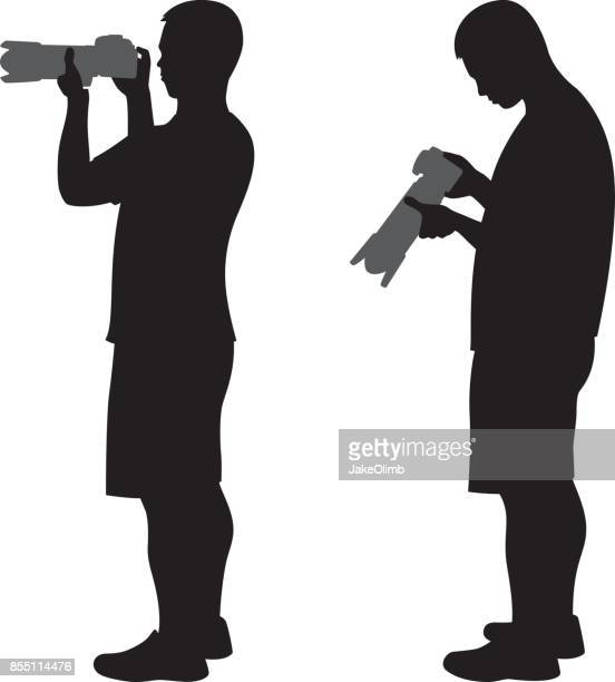 Man Holding Camera with Lens Silhouette