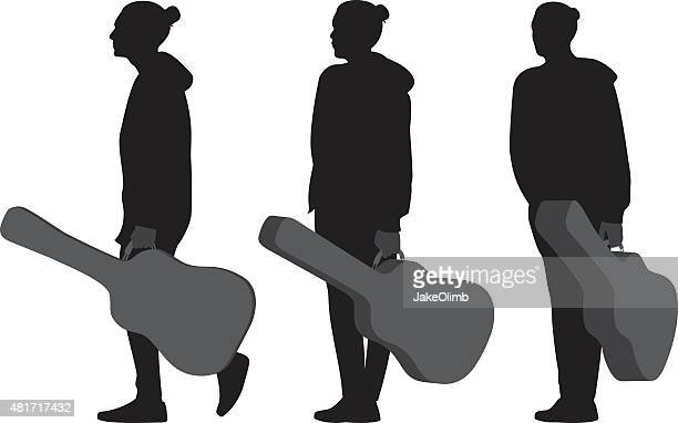 Man Holding Guitar Case Silhouettes