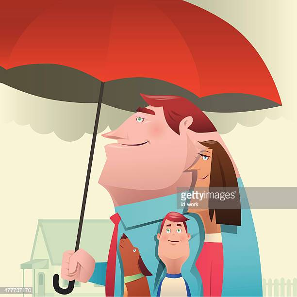 man holding umbrella with family