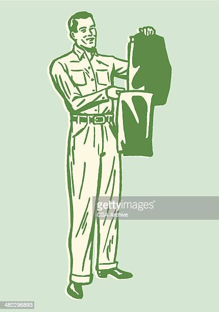 man holding up pressed pants - trousers stock illustrations