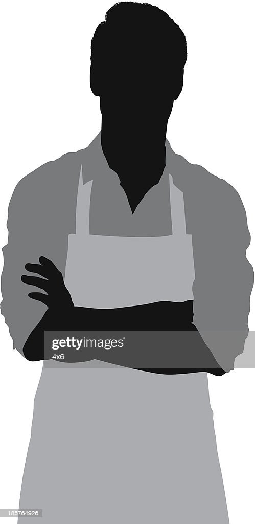 Man in apron standing with arms crossed
