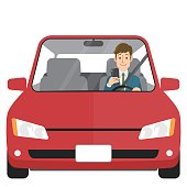 Man in car looking at smartphone
