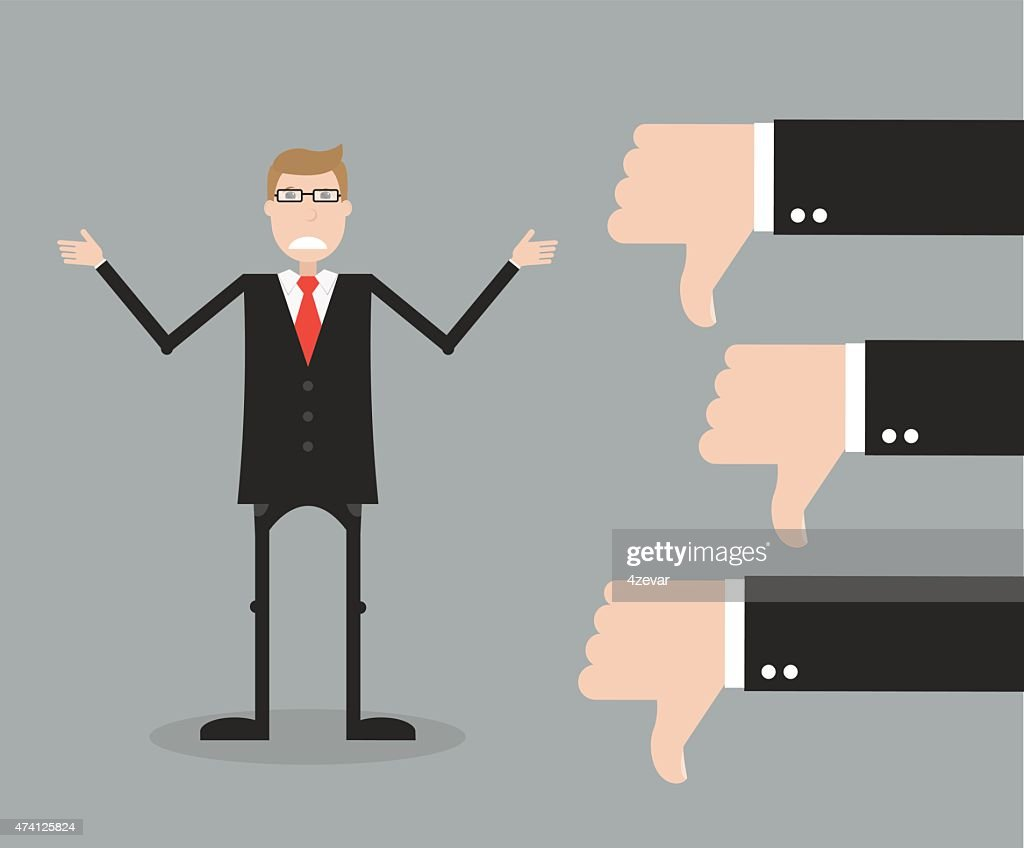 Man in suit receiving three thumbs down