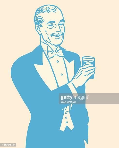 Man in Tuxedo Holding Drink