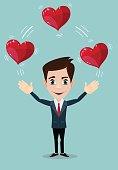 Man juggling hearts